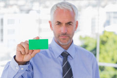 Businessman showing green business card Royalty Free Stock Photos