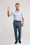 Businessman showing greeting gesture with palm Royalty Free Stock Image