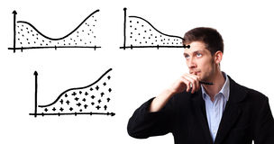 Businessman showing growth of profit on sales. Successful businessman showing growth of profit on sales on a whiteboard Stock Image