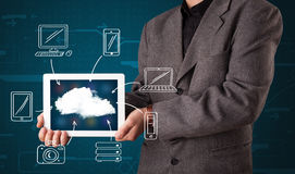 Businessman showing hand drawn cloud computing Royalty Free Stock Photos