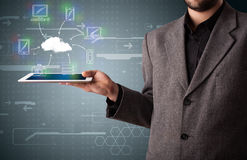 Businessman showing hand drawn cloud computing Royalty Free Stock Image