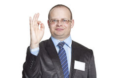 Businessman showing hand gesture ok Stock Photos