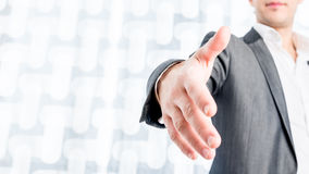Businessman Showing Handshake Gesture in Close up Royalty Free Stock Image