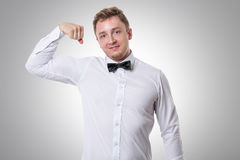 Businessman showing his bicep Stock Photography