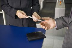 A businessman showing his boarding pass at the check in counter. Royalty Free Stock Photography