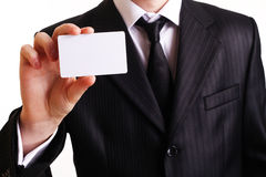 Businessman showing his business card Royalty Free Stock Images