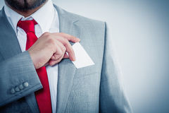 Businessman showing his business card. Copyspace available Royalty Free Stock Image