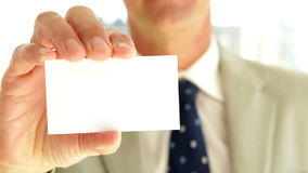 Businessman showing his card to camera Stock Image