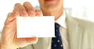 Businessman showing his card to camera stock video