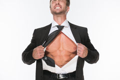 Businessman showing his chest Stock Photos