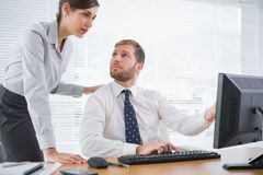 Businessman showing his co worker something on computer Royalty Free Stock Photo