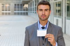 Businessman showing his credentials with space for copy.  royalty free stock photography