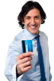 Businessman showing his credit card Royalty Free Stock Images