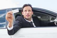 Businessman showing his driver license Royalty Free Stock Image