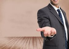 Businessman showing his empty hand Royalty Free Stock Photo