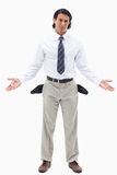 A businessman showing his empty pockets Stock Photo
