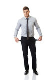 Businessman showing his empty pockets. Stock Photo