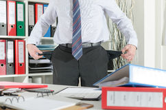 Businessman showing his empty pockets Stock Photo