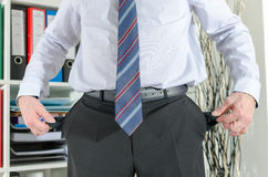 Businessman showing his empty pockets Royalty Free Stock Photo