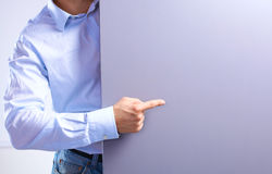 Businessman showing his finger at the advertising poster royalty free stock images