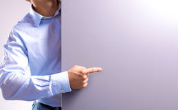 Businessman showing his finger at the advertising poster royalty free stock photo