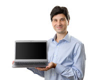 Businessman showing his laptop. With blank screen stock photography