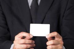 Businessman showing his name card. A Businessman showing his name card Stock Photography