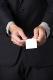 Businessman showing his name card. A Businessman showing his name card Royalty Free Stock Photo