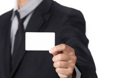Businessman showing his name card with space for copy. A Businessman showing his name card with space for copy Stock Photography