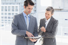 Businessman showing his notes to his colleague Stock Image