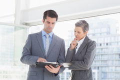Businessman showing his notes to his colleague Stock Photos