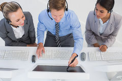 Businessman showing his screen to the team Stock Image