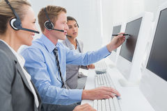 Businessman showing his screen to the team Royalty Free Stock Images