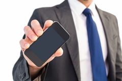 Businessman showing his smartphone screen Stock Images