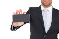 Businessman showing his smartphone screen Stock Image