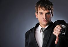 Businessman showing his thumb down Royalty Free Stock Photography