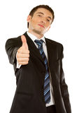 Businessman showing his thumbs up. Happy businessman showing his thumbs up with smile over white background Royalty Free Stock Photography