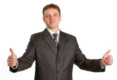Businessman showing his thumbs up with smile over white. Happy businessman showing his thumbs up with smile over white background Stock Photography