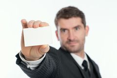 Businessman showing his visiting card Stock Images