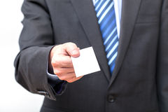 Businessman showing his visiting card Royalty Free Stock Images