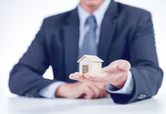 Businessman showing home on hand royalty free stock photo