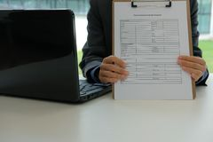 Businessman showing home insurance quote request. Form stock images