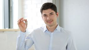 Businessman Showing House Keys, Engineer royalty free stock image