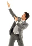 Businessman showing imaginary product Royalty Free Stock Image