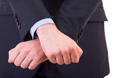 Businessman showing jail gesture with his hands. Royalty Free Stock Image
