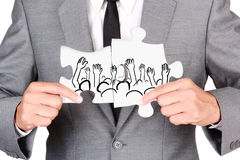Businessman showing jigsaw connect create people hand up Stock Image