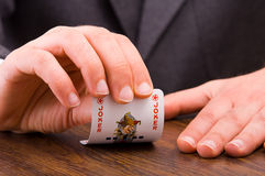 Businessman showing joker card. Stock Photo