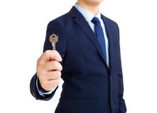 Businessman showing key to success Royalty Free Stock Images