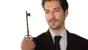 Businessman showing the key to success Stock Photography