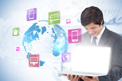 Businessman showing laptop with app icons Stock Images